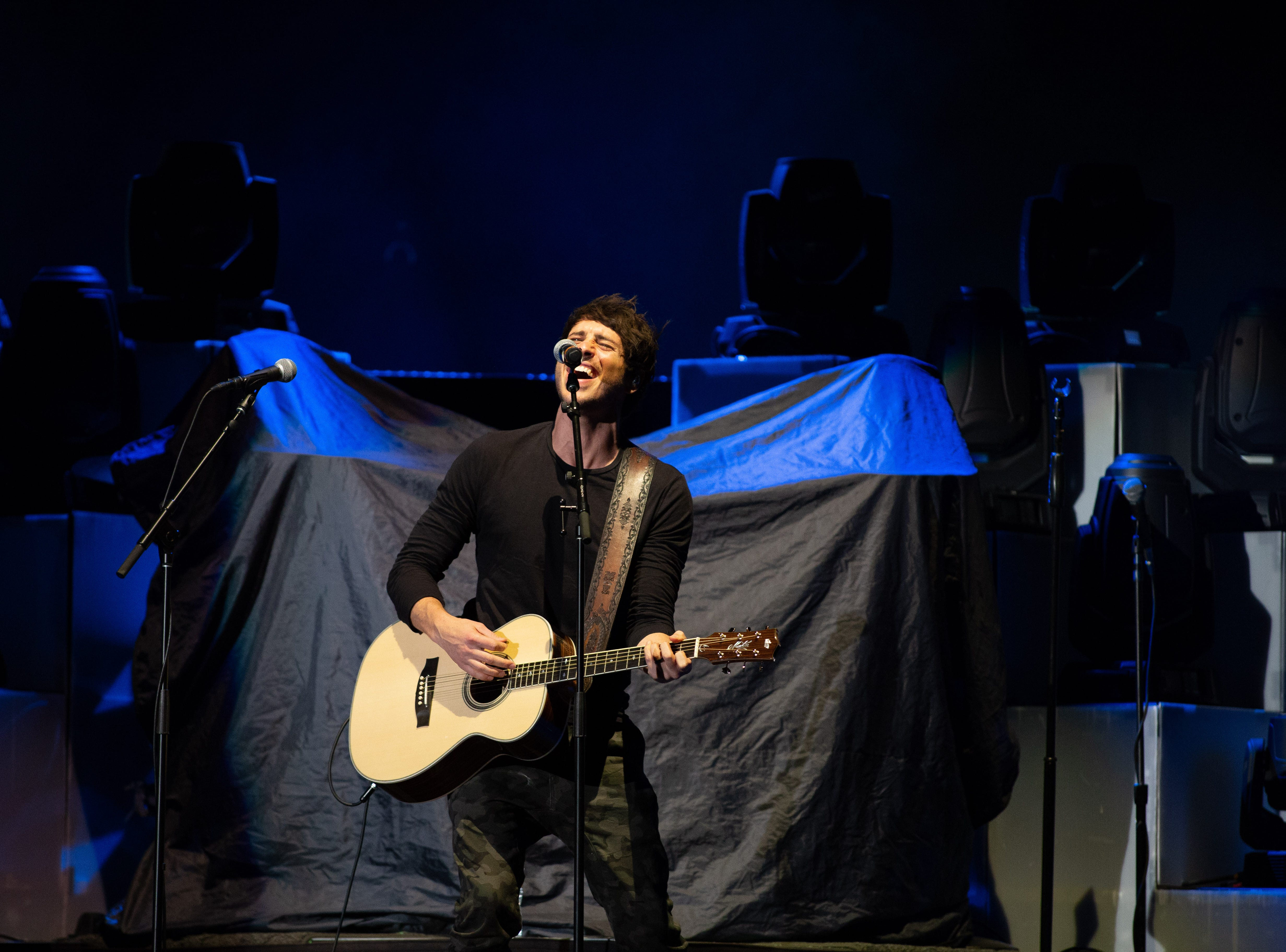 Morgan Evans warms up the crowd with his original songs at the Chris Young concert held at the Pan Am Center in Las Cruces on Thursday, Sept. 13, 2018.
