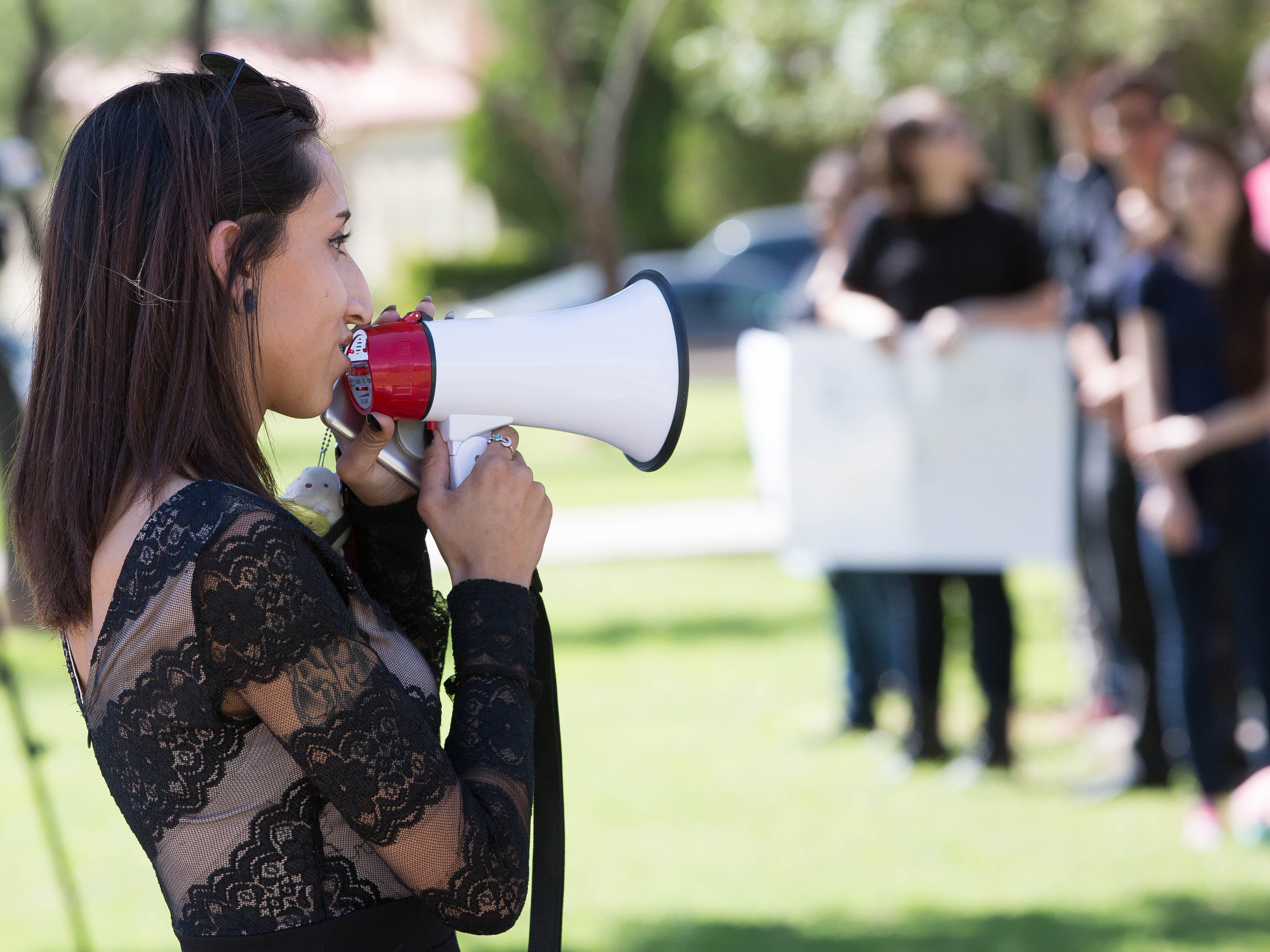 Mariyah Lopez, 18, uses a bullhorn to address her fellow student protesters outside of Alma d'Arte arts charter school, Friday September 14, 2018. Students at Alma d'Arte Protest the termination of two staff, a teacher and a special education coordinator, along  with some student expulsions.