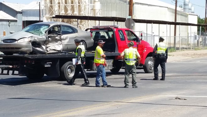 Authorities respond to a vehicle crash Friday, Sept. 14, 2018, at the intersection of NM Hwy. 28 and Union Avenue, south of Mesilla.