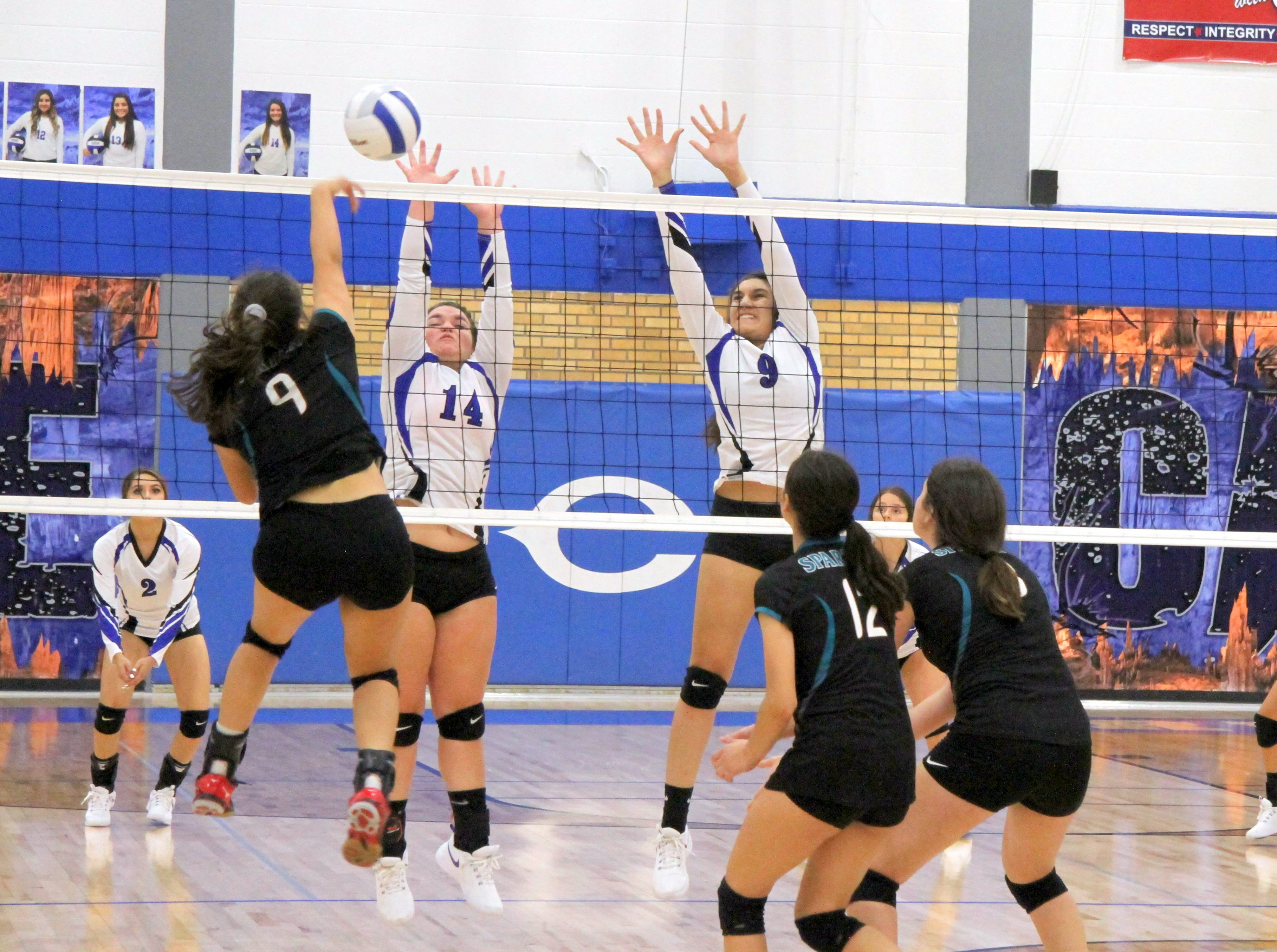 Carlsbad's Danaye Boss (14) and Serena Rodriquez (9) go for a block during Thursday's match against Pebble Hills.