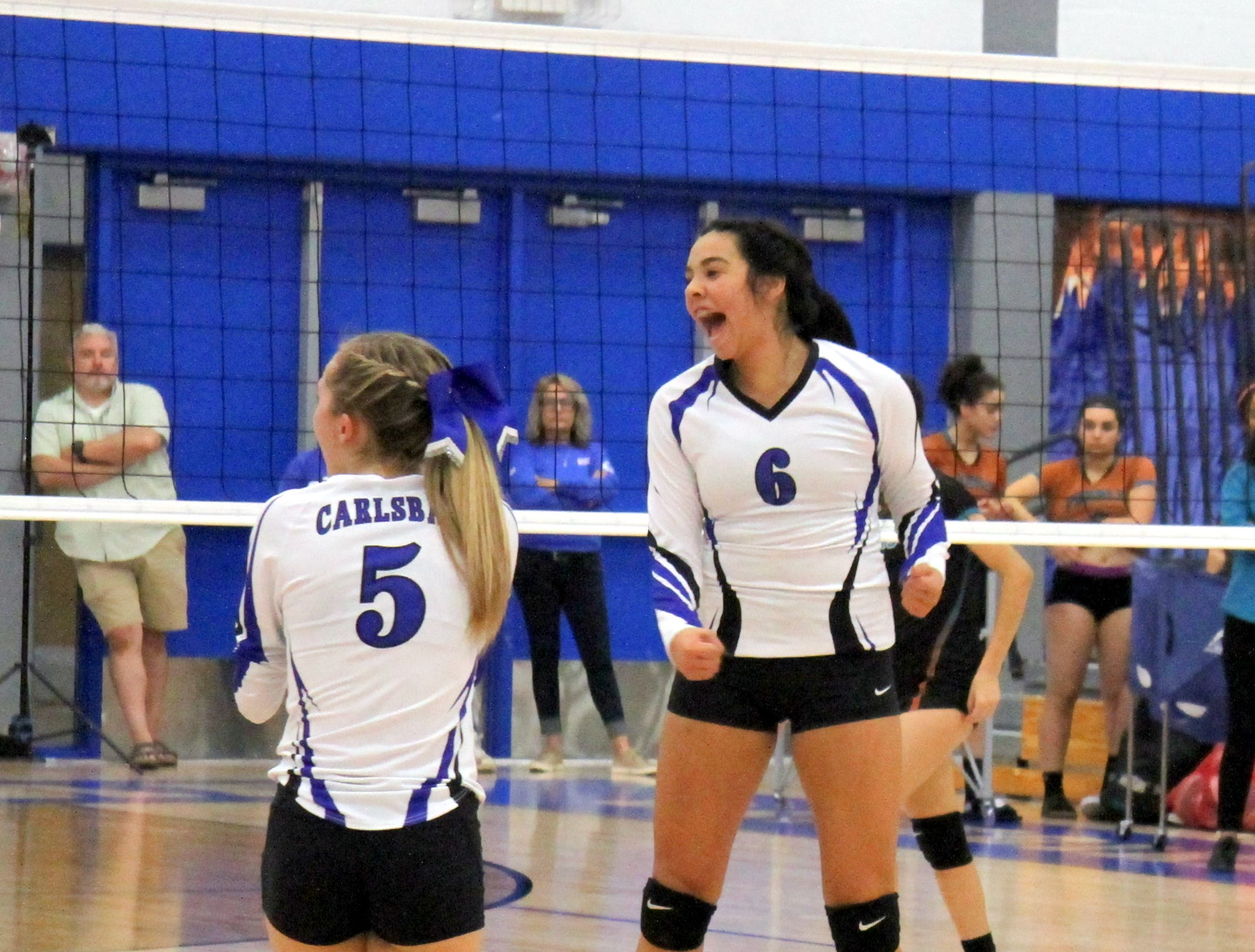 Aubryanna Leos (6) celebrates a kill in the third set of Thursday's match against Pebble Hills.