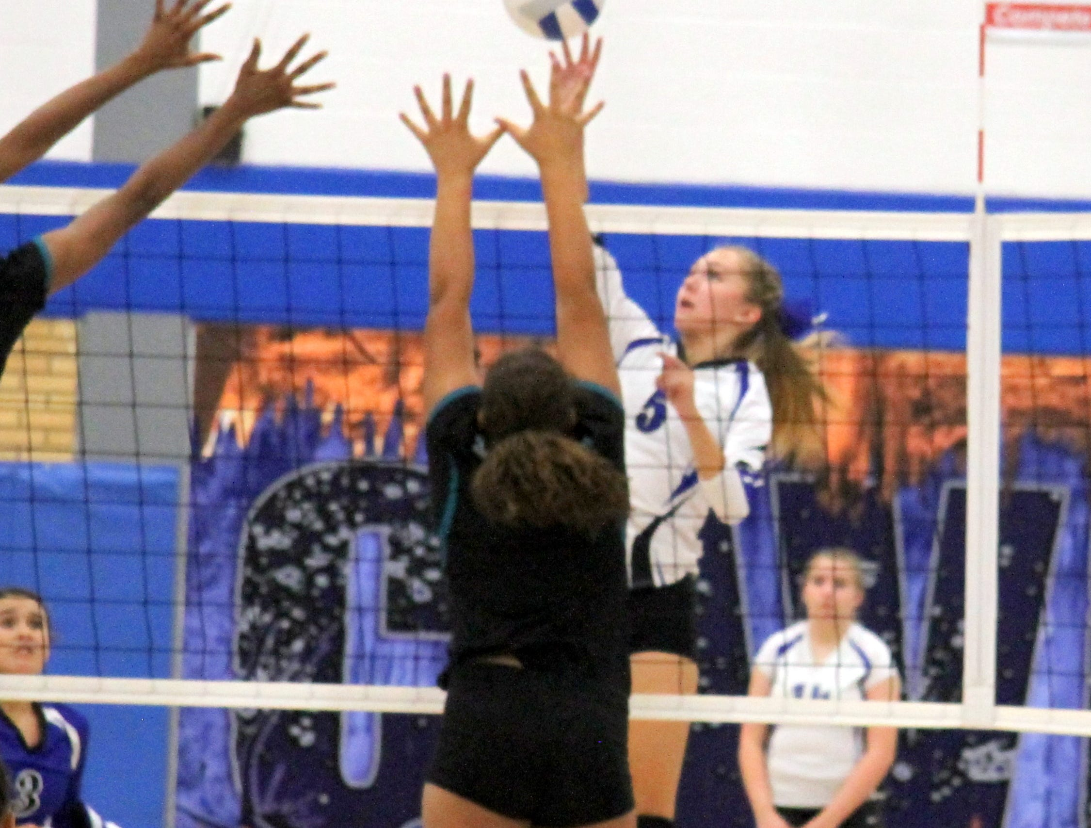 Alexa Sowers tips the ball in the fourth set of Thursday's match against Pebble Hills.