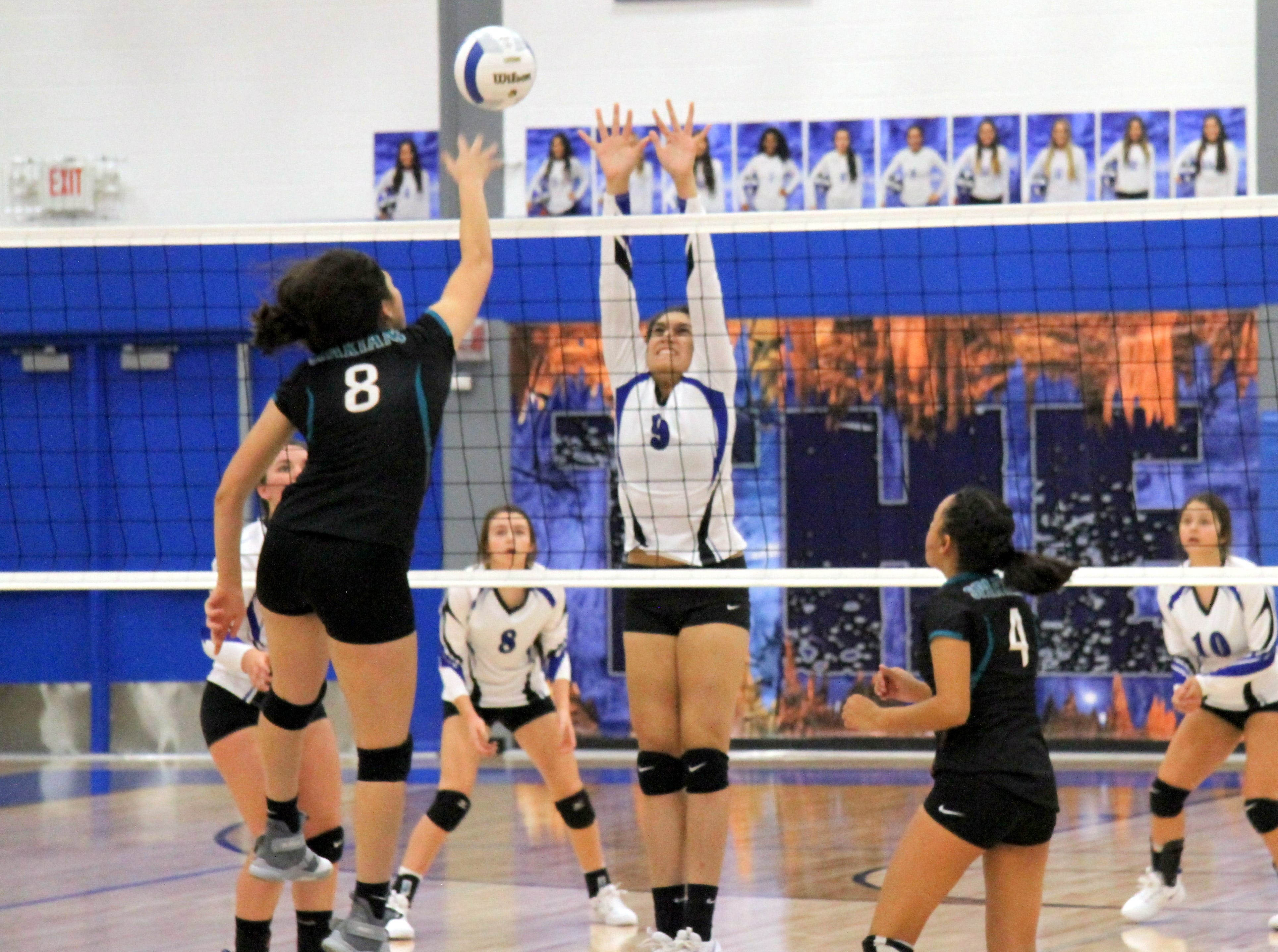 Serena Rodriquez goes for a block in the fourth set of Thursday's match against Pebble Hills.
