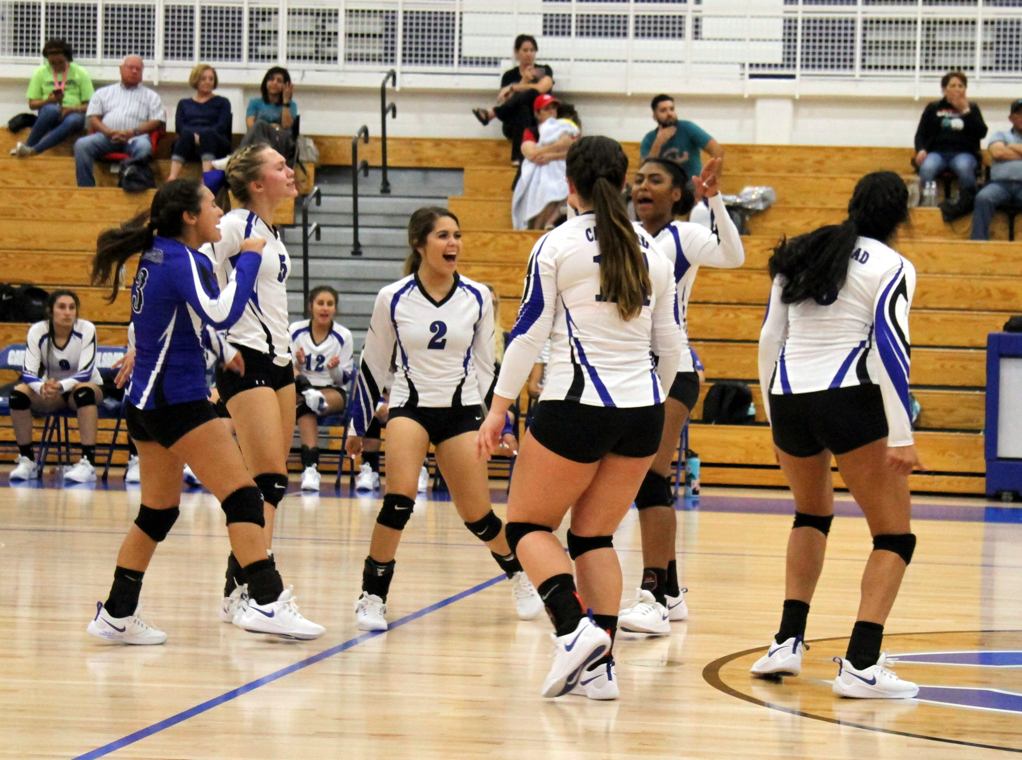 Carlsbad celebrates a point in the middle of the fourth set during Thursday's match against Pebble Hills.
