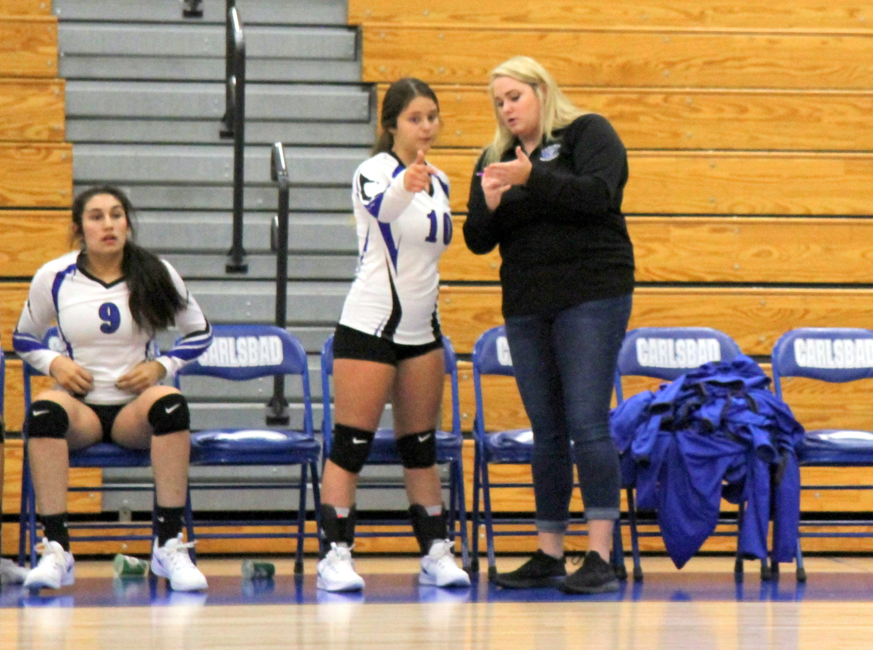 Diamond Morrill and Chloe Garcia (10) go over the gameplan during Thursday's match against Pebble Hills.