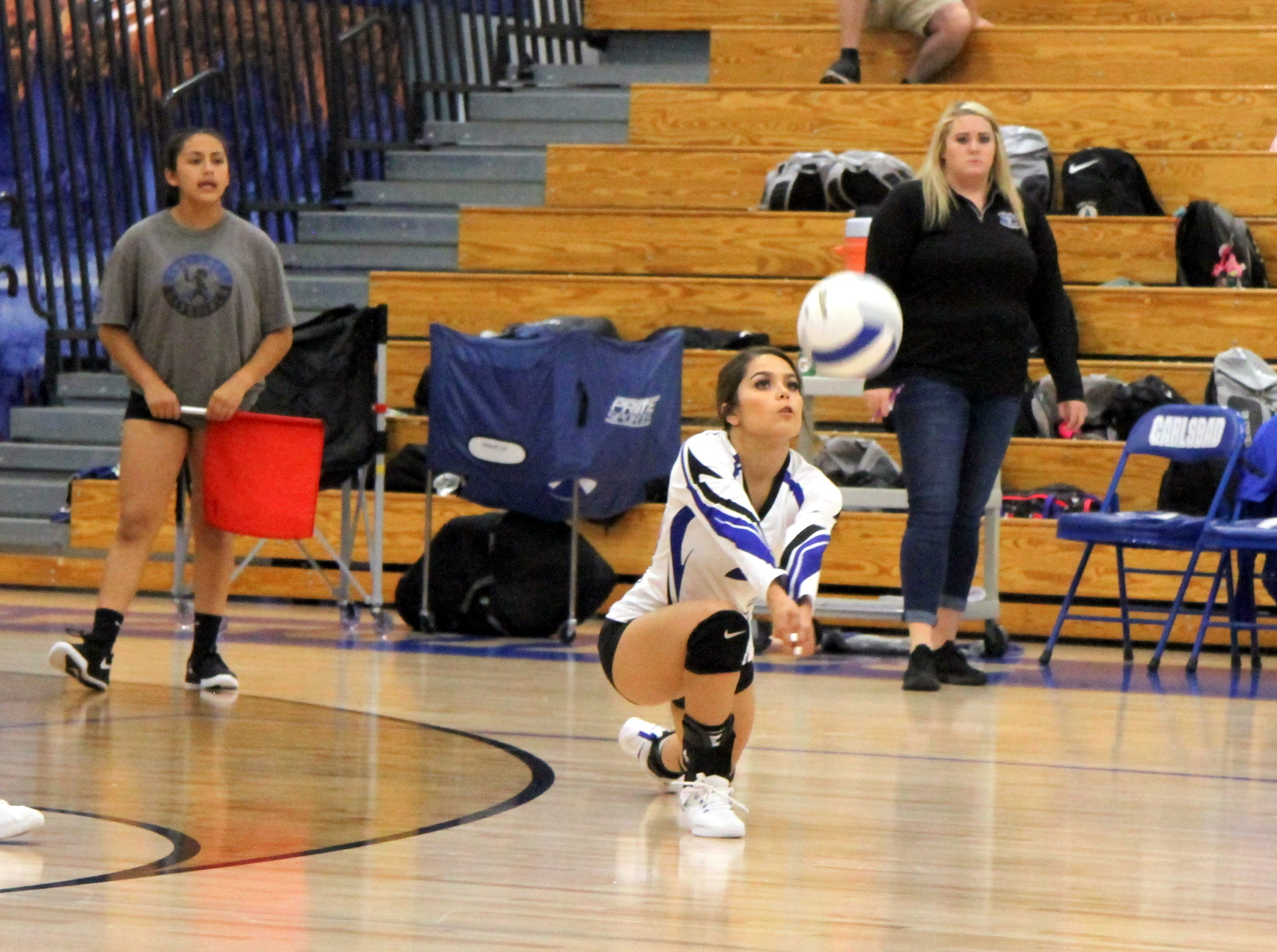 Alycia Cruz digs a ball in the second set of Thursday's match against Pebble Hills.