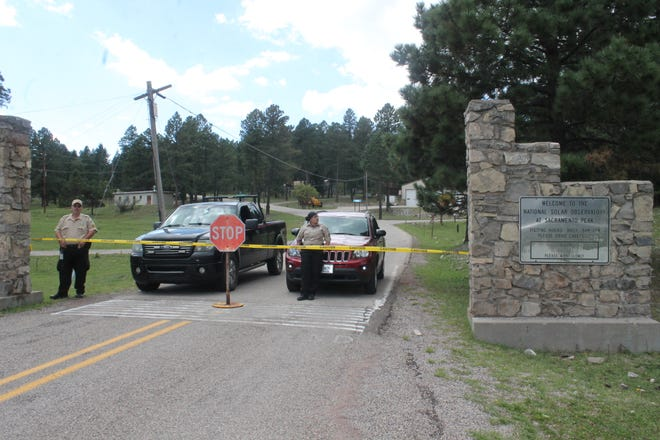 Security guards are stationed at entrance to the Sunspot Observatory on Friday, Sept. 14, 2018, to turn away the visitors curious about the site's sudden closure.