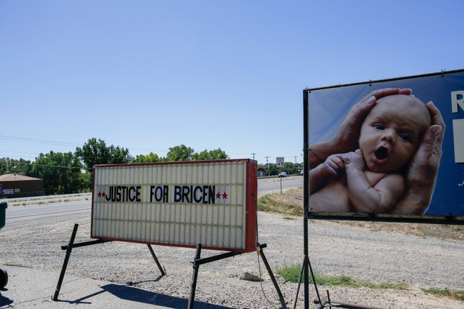 "A ""Justice for Bricen"" sign is displayed Friday adjacent to a shopping centeron N.M. Highway 516 in Flora Vista."