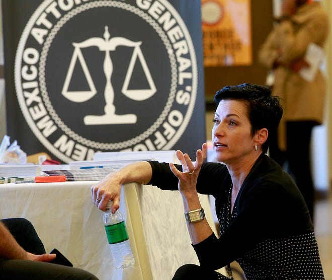 In this file photo Elizabeth Korsmo, an attorney with the office of Attorney General Hector Balderas, talks with other attorneys on Friday, Sept. 16, 2016, at the Eleventh Judicial District Court in Aztec during the San Juan County Legal Fair.