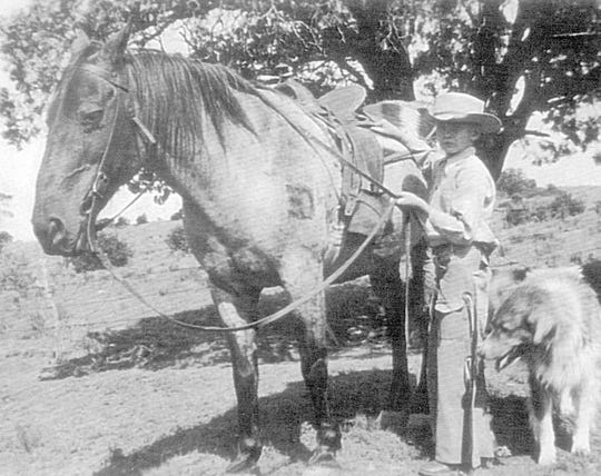 "Tom ""Skipper"" Gould poses with his horse."