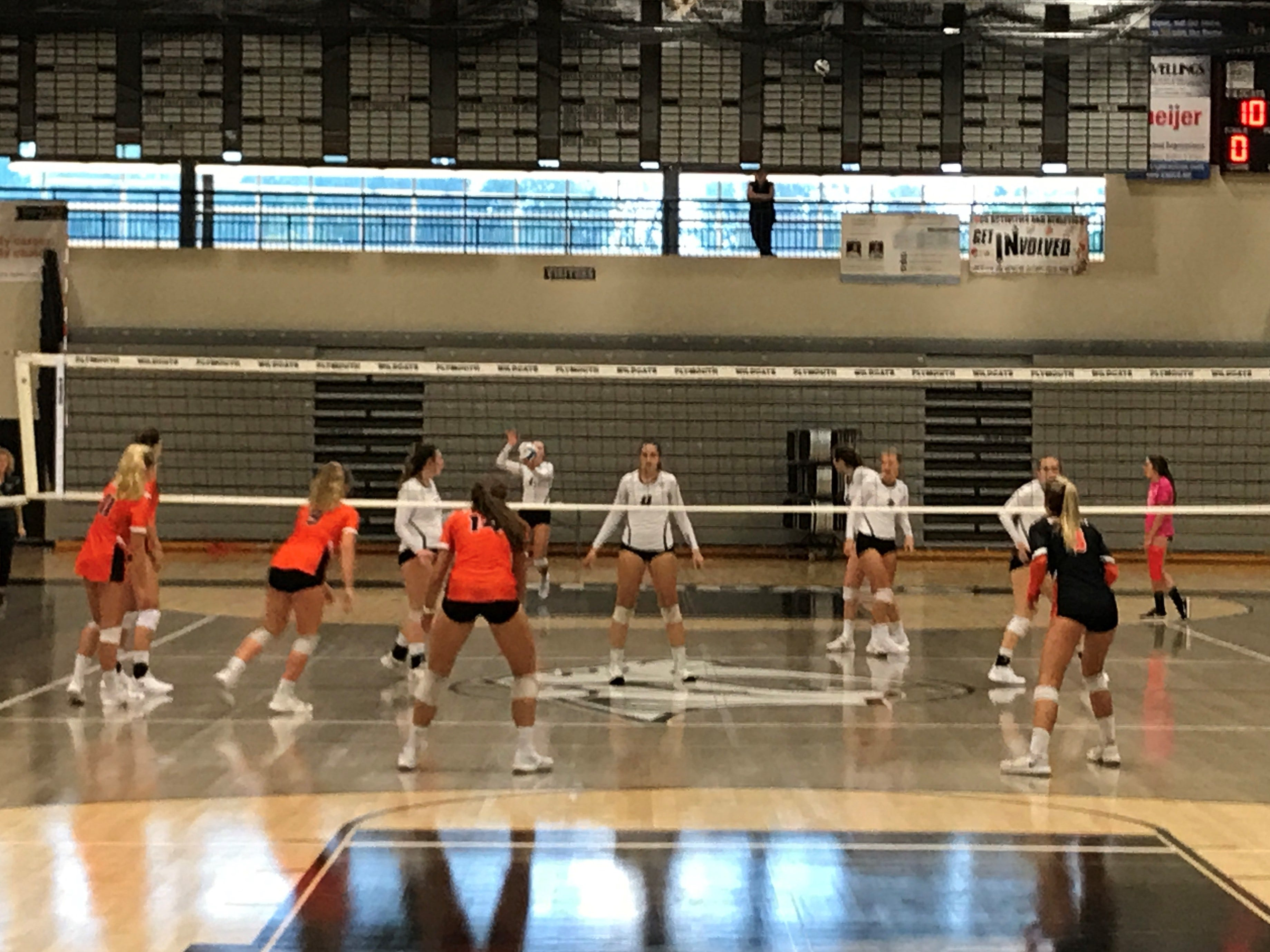 Northville players await the serve from the Plymouth side of the net.