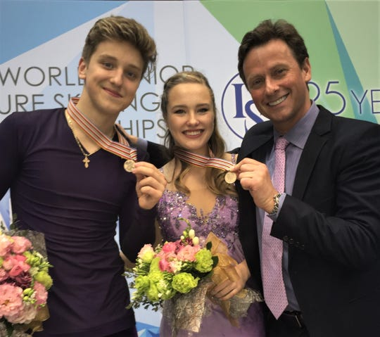 Ice dance coach Igor Shpilband (right) with 2018 U.S. Junior champions Anthony Ponomarenko and Christina Carreira.