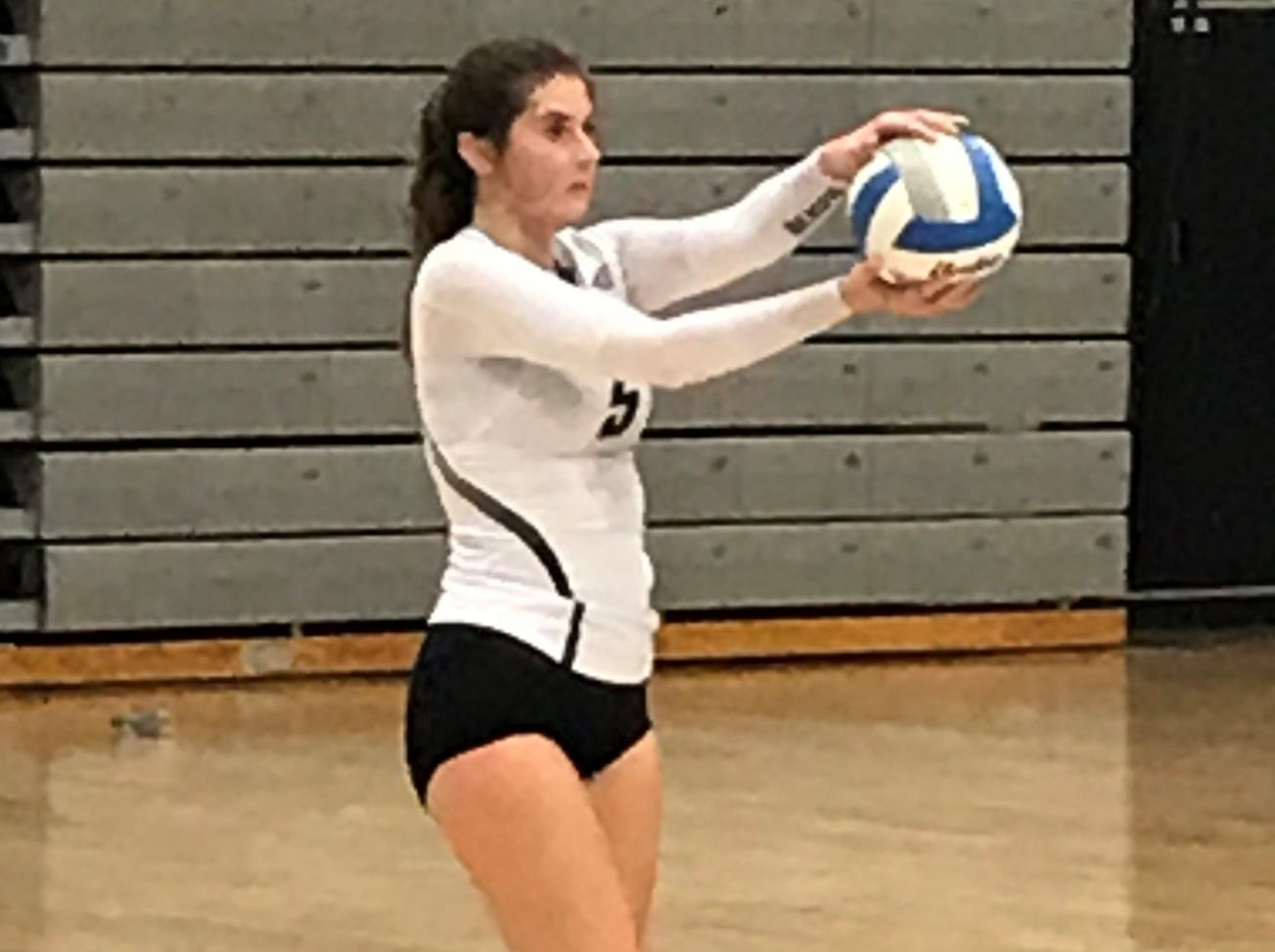 Getting set to serve for Plymouth is Hailey Wasik (5).