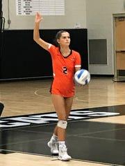 Northville senior Gabi Fisette gets ready to serve against Plymouth.