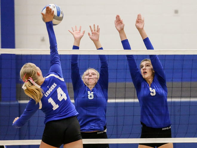 Winnebago Lutheran Academy volleyball's Meaghan Doyle and Shania Shea go up to block a hit by St. Mary's Springs Academy's Peyton Walters Thursday, September 13, 2018, during their game in Fond du Lac, Wisconsin.