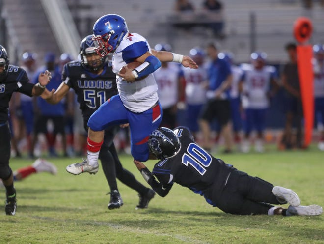 Indio quarterback Aubuchon Martinez jumps for a first down against Cathedral City, September 13, 2018
