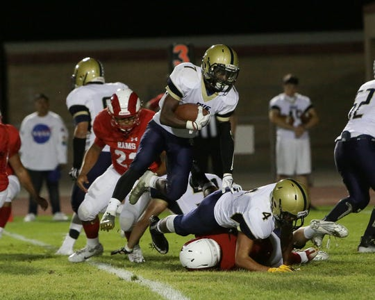 Desert Hot Springs' Alonzo Moss (7) runs with the football against Desert Mirage on Sept. 13, 2018.