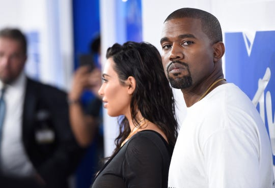 """In this Aug. 28, 2016 file photo, Kim Kardashian West, left, and Kanye West arrive at the MTV Video Music Awards in New York. Kanye West has apologized on a Chicago radio station for suggesting slavery was a """"choice."""" (Photo by Evan Agostini/Invision/AP, File)"""