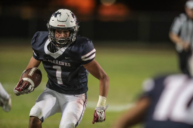 La Quinta's Marcus McAvoy carries the ball against Murrieta Mesa on Thursday, September 13, 2018 in La Quinta.