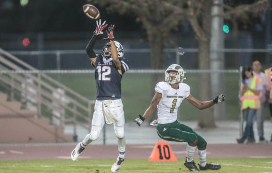 La Quinta's Nathaniel Perez intercepts a pass intended for Murrieta Mesa's Damian Thompson in the first quarter on Thursday, September 13, 2018 in La Quinta.