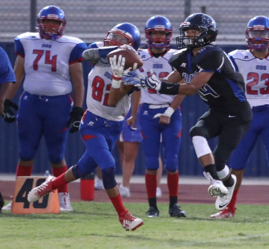 Indio's Joseph Sanchez picks off a Cathedral City pass on the first play of the game, September 13, 2018