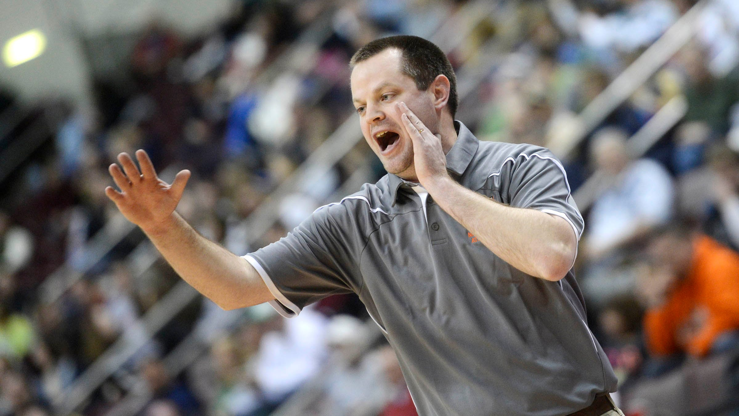 In this file photo from 2014, Hanover coach Nathan Myers yells from the sideline during the boys' basketball District 3 Class AA championship game at the Giant Center in Hershey Friday, February 28, 2014. Hanover lost to Trinity 55-46.