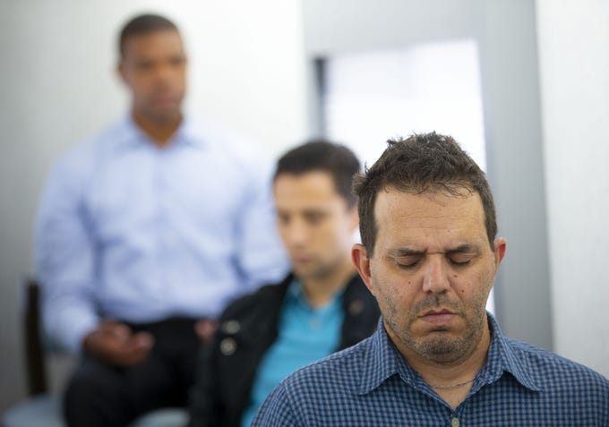 Lee Eisner, a Mobile Mini employee, relaxes during a M2 mindfulness class in Phoenix on Sept. 5, 2018. M2 is a Phoenix-based mobile company that brings mindfulness classes and resources to companies in the Valley.
