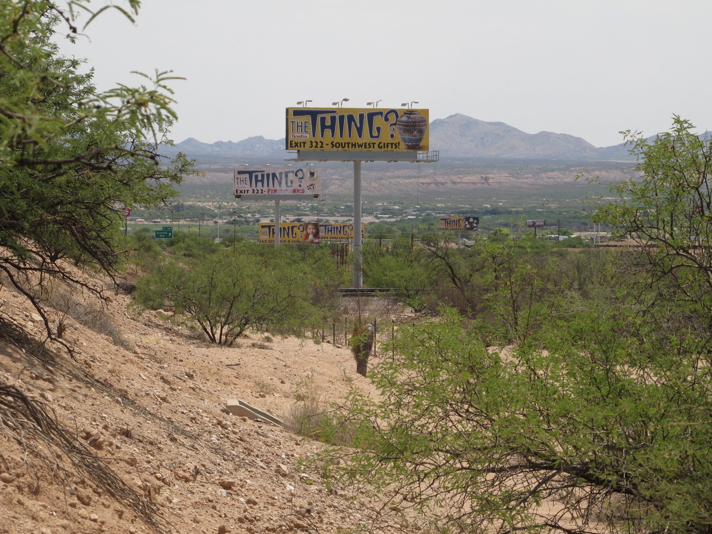 Billboards in Benson, along Interstate 10 East, pitch the Thing in Texas Canyon in the Dragoon Mountains.