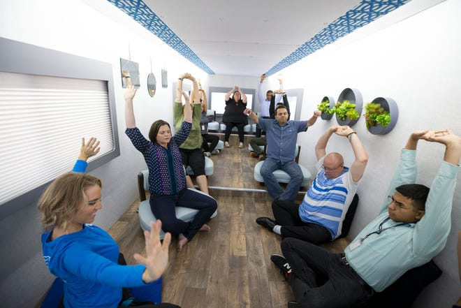 M2 instructor Julia Pearl (left) leads a relaxation class for Mobile Mini employees in Phoenix on Sept. 5, 2018. M2 is a Phoenix-based mobile company that brings mindfulness classes and resources to companies in the Valley.