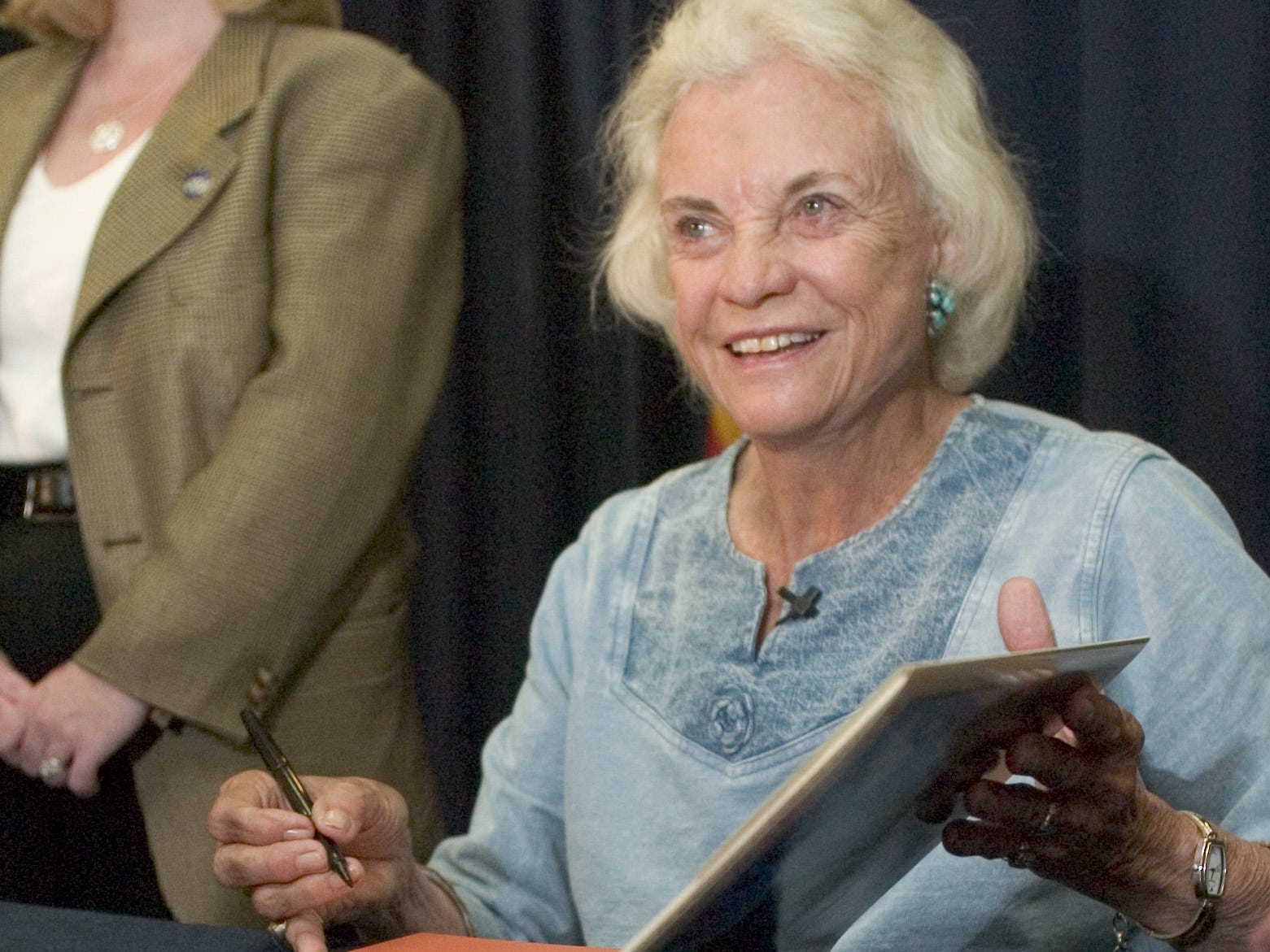 Justice Sandra Day O'Connor visits with the public during a book signing at the Scottsdale Civic Center Library on Sept. 18, 2005. Justice O'Connor visited the library to talk about her childhood growing up in Arizona and her new book.