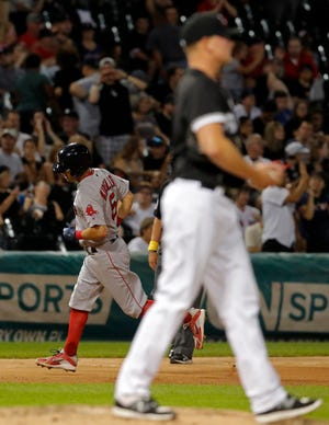 Boston Red Sox second baseman Ian Kinsler (5) rounds the bases after hitting a home run off Chicago White Sox relief pitcher Ryan Burr (61) during the eighth inning at Guaranteed Rate Field this season. Both Kinsler and Burr played at Arizona State.