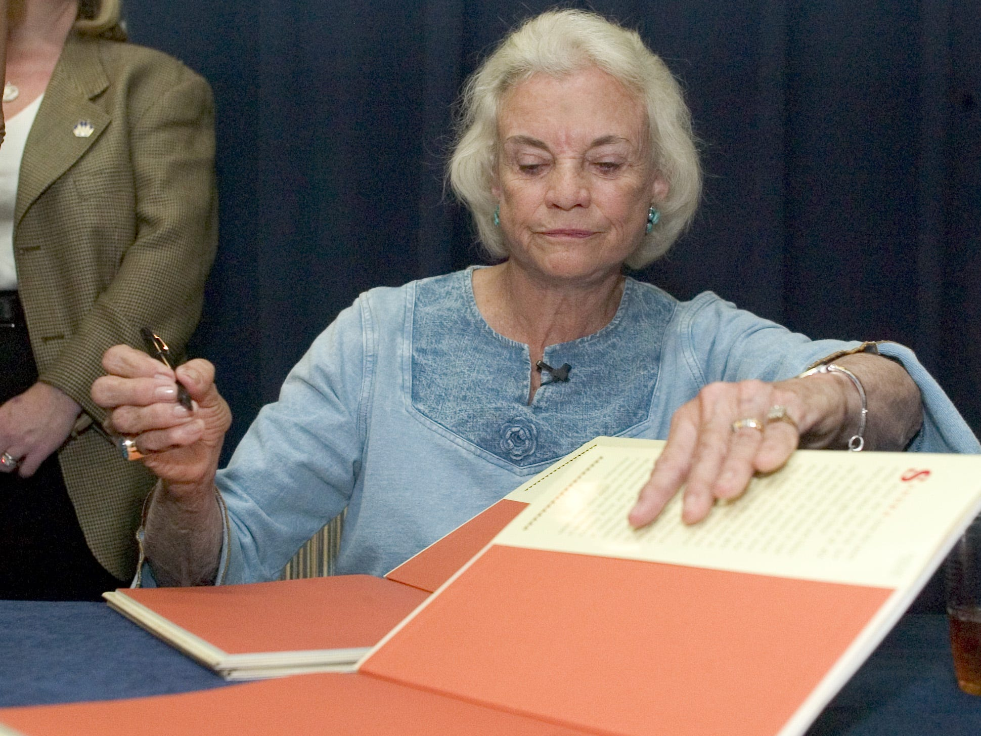 Justice Sandra Day O'Connor signs copies of her newly released children's book, Chico, on Sept. 18, 2005, at the Scottsdale Civic Center Library.  Justice O'Connor visited the library to talk about her childhood growing up in Arizona and her new book.