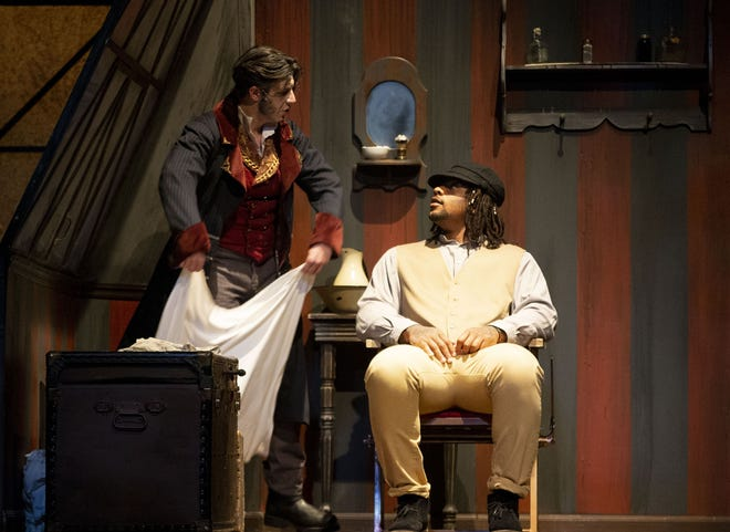 """Tony Edergerton playing Sweeney Todd and Cardinals defensive tackle Robert Nkemdiche playing Customer #2 act in the Herberger Theater's performance of """"Sweeney Todd"""" on Thursday. Nkemdiche had a special guest cameo for that night's performance."""