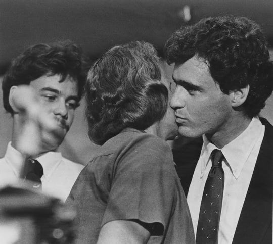 Sandra Day O'Connor, nominated for the U.S. Supreme Court, gets a kiss from one of her three sons, Scott, while another, Brian, looks on. The third, Jay and their father, John Jay O'Connor III, also attended the news conference in Phoenix, which followed President Reagan's announcement in Washington, D.C., in 1981.