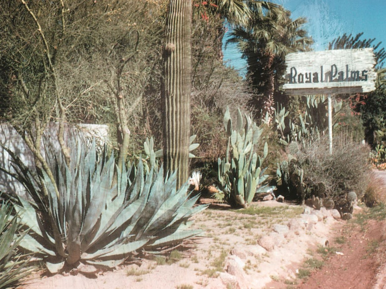 An historic photo of the front entrance sign at the Royal Palms Resort and Spa.