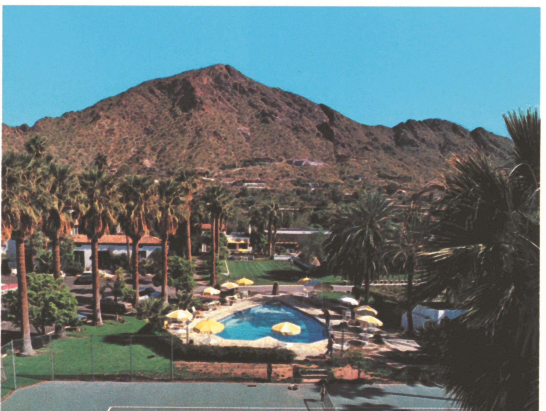 An historic look at the Royal Palms Resort and Spa's heart-shaped pool and adjacent tennis court.