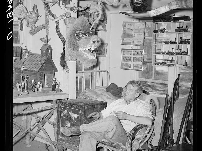 Homer Tate was known for creating odd creatures. He relaxes in his studio in this May 1940 photo.