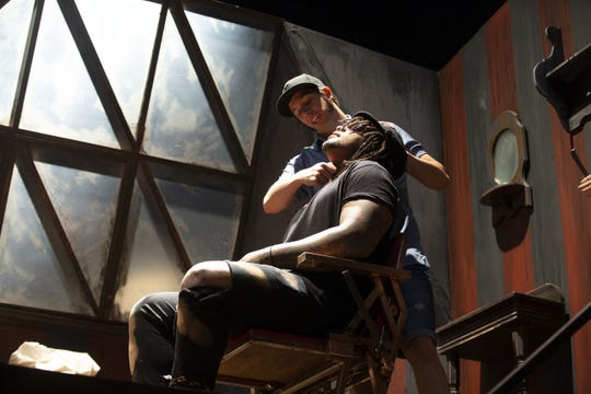 """Tony Edergerton, playing Sweeney Todd, rehearses with Cardinals defensive tackle Robert Nkemdiche for his special guest cameo in the Herberger Theater's performance of """"Sweeney Todd"""" on Thursday"""