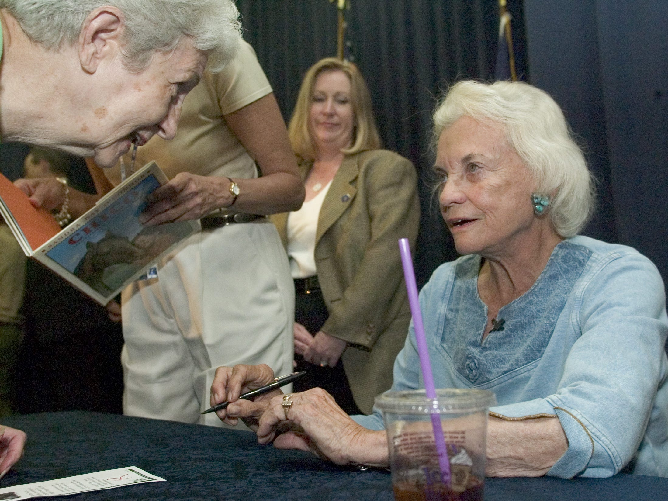 Virginia Rubiak of Scottsdale, (left) exchanges greetings with Justice Sandra Day O'Connor during a book signing at the Scottsdale Civic Center Library, on Sept. 18, 2005. Justice O'Connor visited the library to talk about her childhood growing up in Arizona and her book.