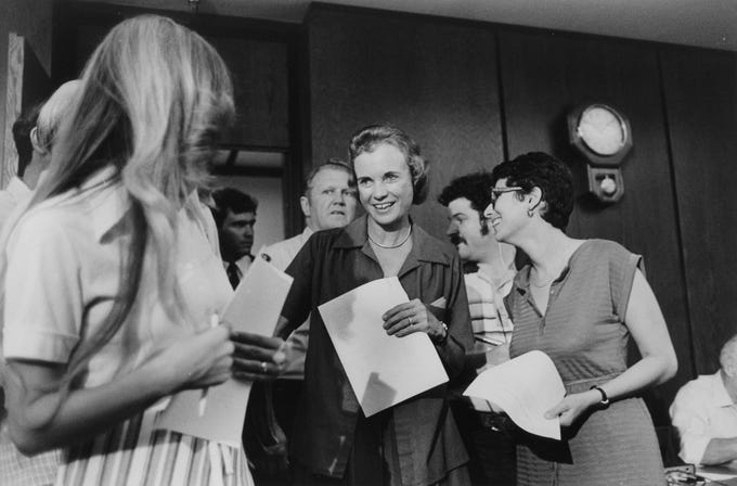 Sandra Day O'Connor enters press conference surrounded by media on July 7, 1981.