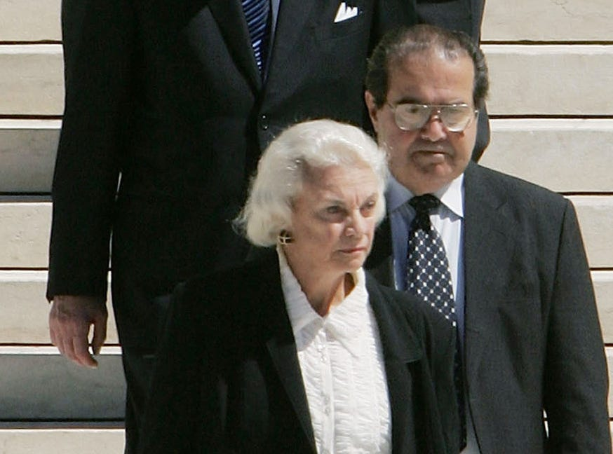 U.S. Supreme Court Justice Sandra Day O'Connor and Justice John Paul Stevens file out of the Supreme Court Building to attend funeral services for former Chief Justice William Rehnquist on Sept. 7, 2005, in Washington, D.C.