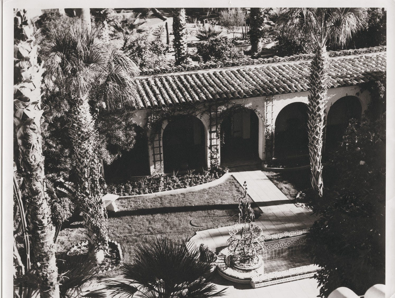 An historic black-and-white photo of the courtyard at Royal Palms Resort and Spa.