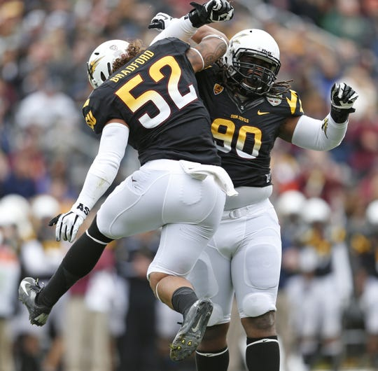 Carl Bradford celebrates a sack with Will Sutton (right) during the Kraft Fight Hunger Bowl against Navy on Dec. 29, 2012. The duo are now playing in the XFL.