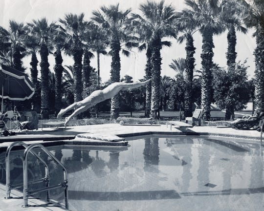 A guest of Royal Palms Resort and Spa dives into the sweetheart pool circa 1950s.