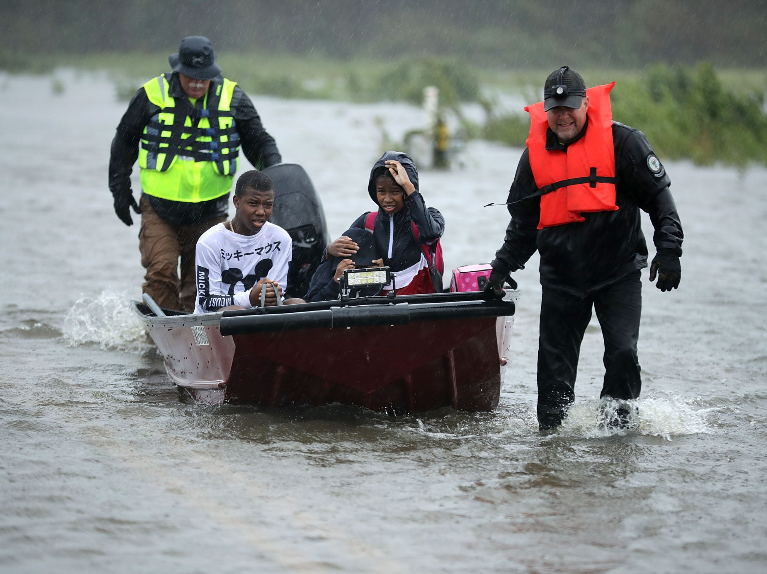 JAMES CITY, NC - SEPTEMBER 14:  Volunteers from the Civilian Crisis Response Team help rescue three children from their flooded home September 14, 2018 in James City, United States. Hurricane Florence made landfall in North Carolina as a Category 1 storm and flooding from the heavy rain is forcing hundreds of people to call for emergency rescues in the area around New Bern, North Carolina, which sits at the confluence of the Nueces and Trent rivers.