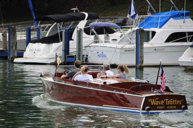 The Wave Trotter heads down the Black River to the St. Clair River on Friday, Sept. 14, 2018 at the Antique and Classic Boat Society's International Boat Show.