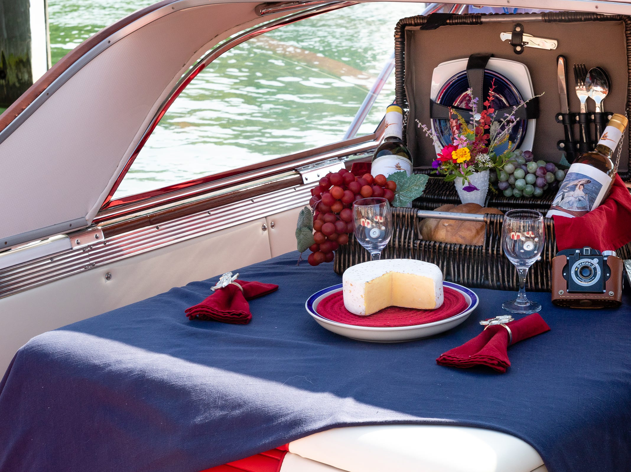 A prepared lunch is displayed on the back of the Timeless, a 1957 Century Friday, Sept. 14, 2018, at River Street Marina during the ACBS International Boat Show.