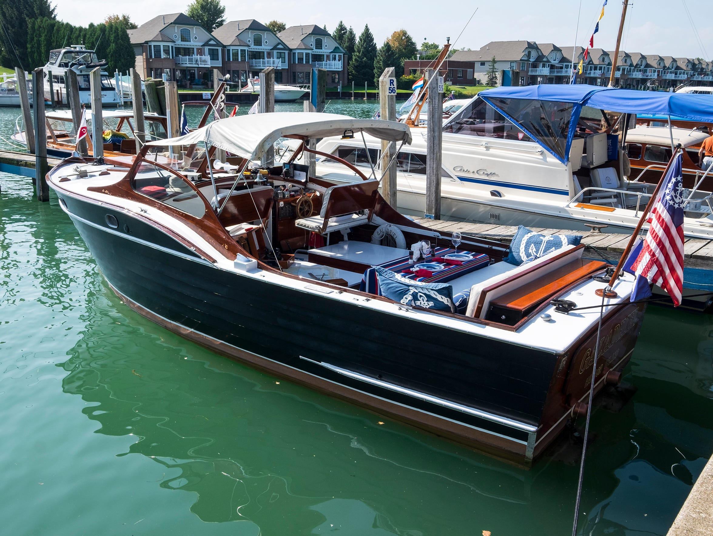 The Galadriel, a 25-foot 1959 Jafco Seamaster, is docked Friday, Sept. 14, 2018, at the River Street Marina during the 2018 ACBS International Boat Show.