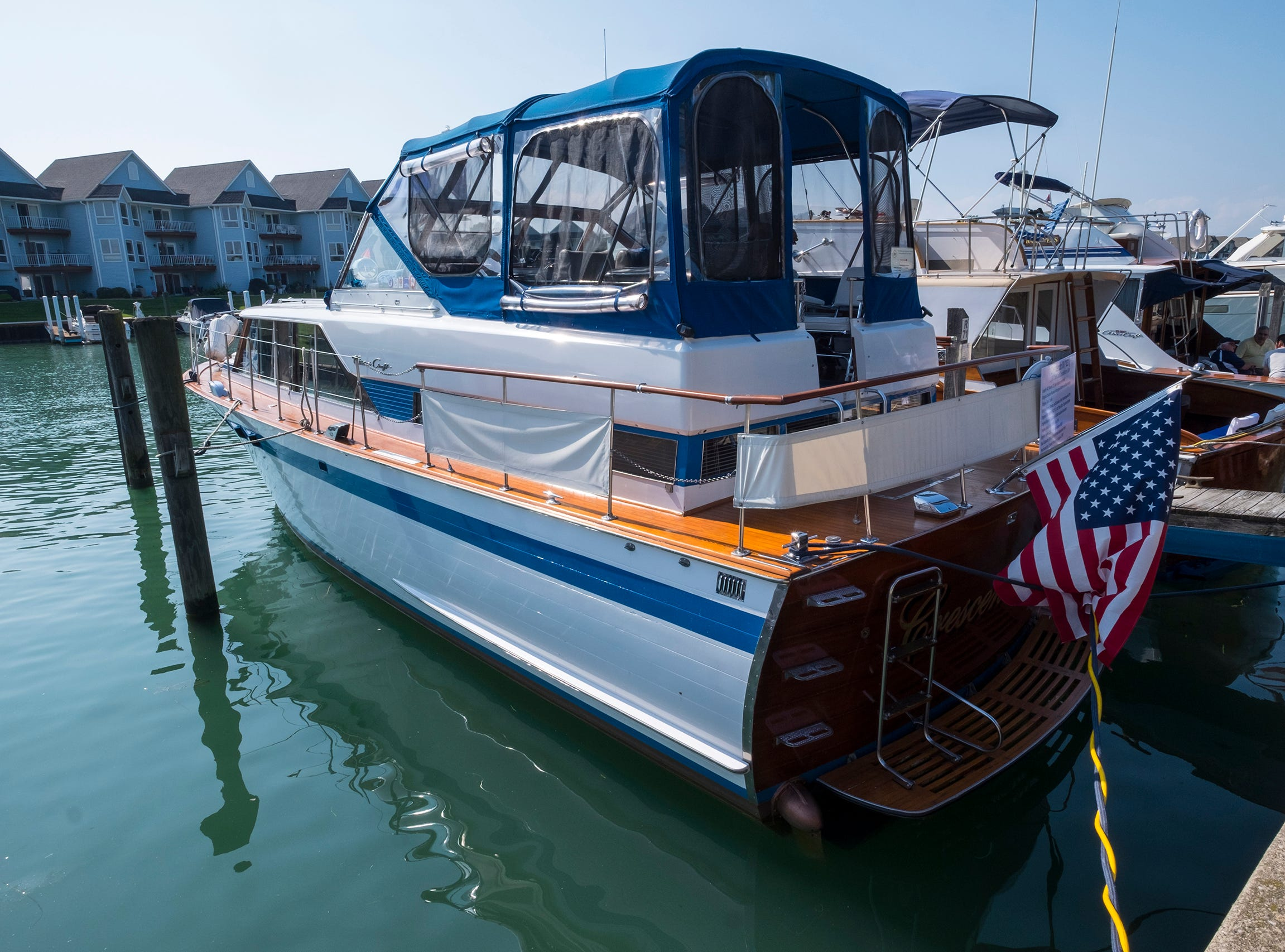 The Crescendo III, a 40-foot 1966 Chris Craft Constellation Salon, sits docked Friday, Sept. 14, 2018, during the 2018 ACBS International Boat Show. THe ship has the original double-planked mahogany bottom and oak framing, original teak decks, brass, bronze and stainless steel fastenings and trim and is powered by the original 427 cubic inch Ford V8 engine.