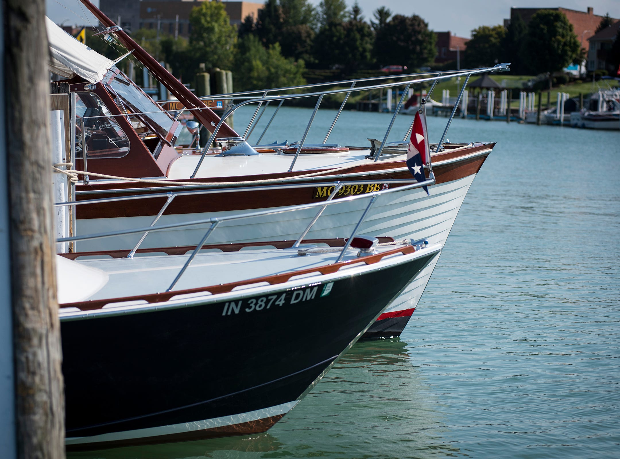 The Old Lady (back), a 1958 Chris Craft Sea Skiff, is docked next to Cracker Jack, a 1964 Chris Craft Cutlass Friday, Sept. 14, 2018, at River Street Marina during the 2018 ACBS International Boat Show.